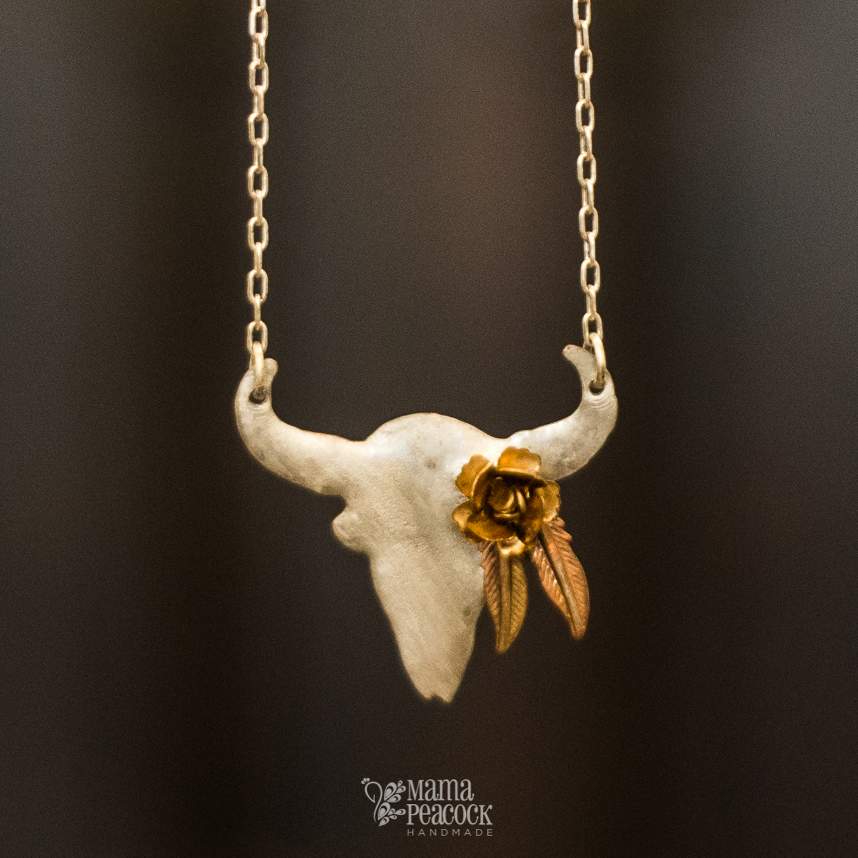 silver buffalo skull with feathers and flowerZ